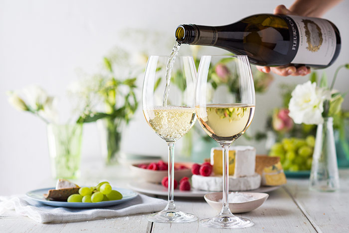Fleur du Cap Unfiltered Chardonnay served with a cheese platter.
