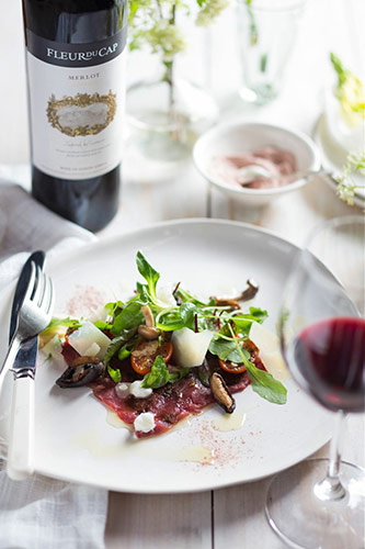 Fleur du Cap Unfiltered Merlot paired with Beef Carpaccio and Kala Namak salt.
