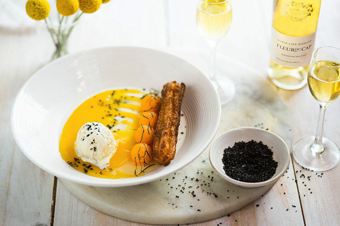 Fleur du Cap Bergkelder Selection Noble Late Harvest paired with Vanilla Panna Cotta, Churros and Mango with Black Lava salt.